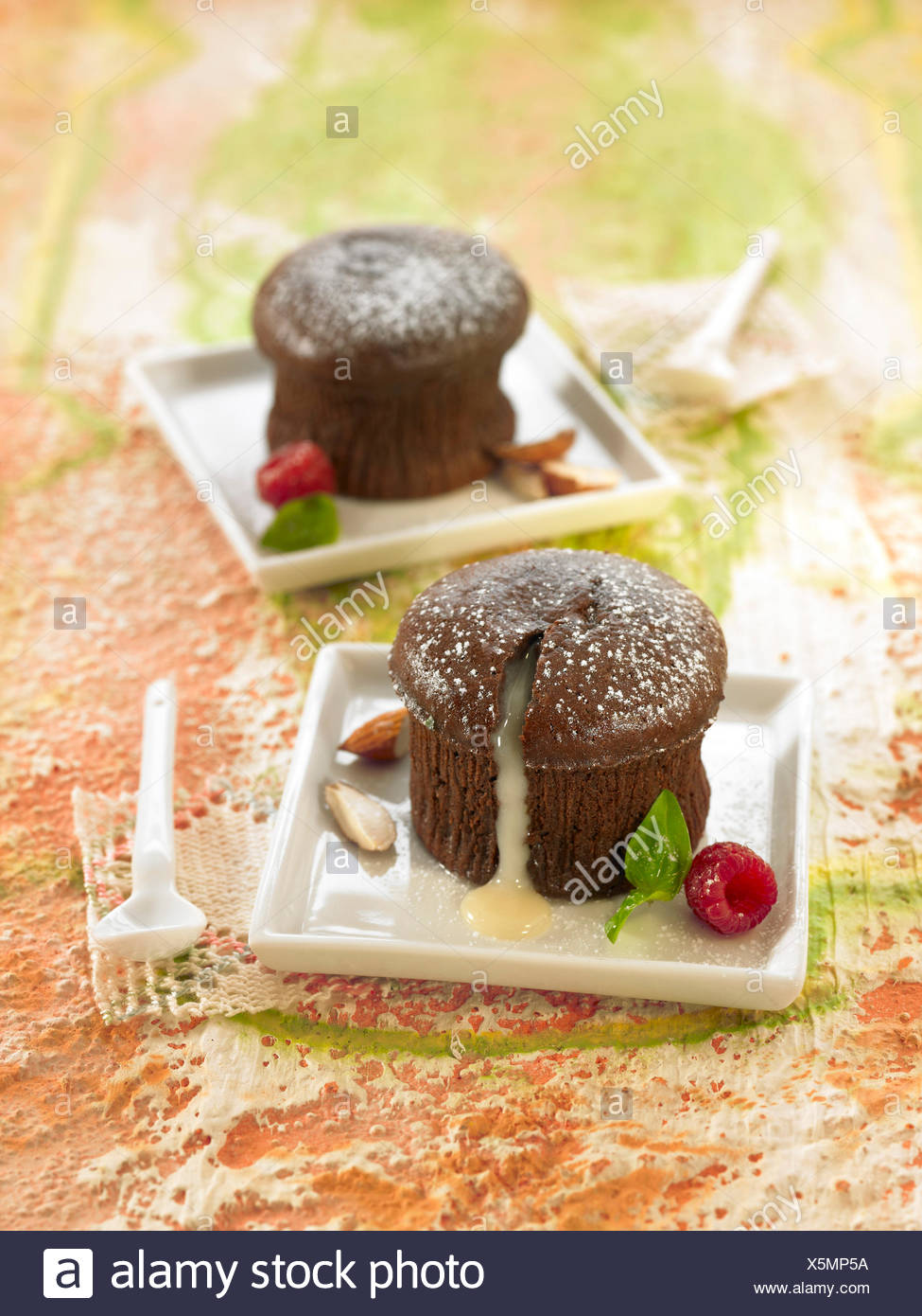 Dark chocolate fondant with a runny white chocolate filling - Stock Image