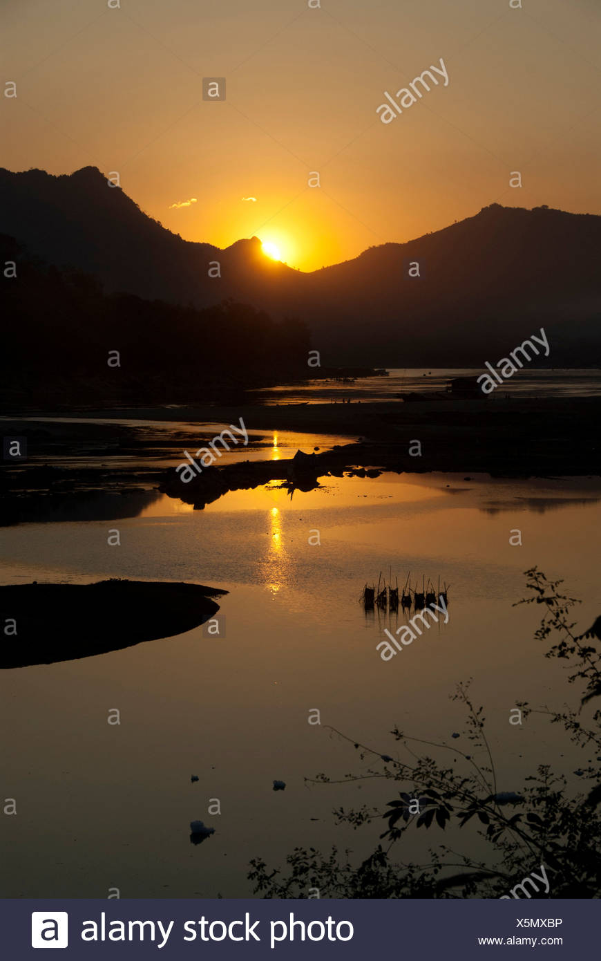 Sunset over the Mekong River, view from the temple of Wat Pha Bhat Tai, Luang Prabang province, Laos, Southeast Asia, Asia - Stock Image