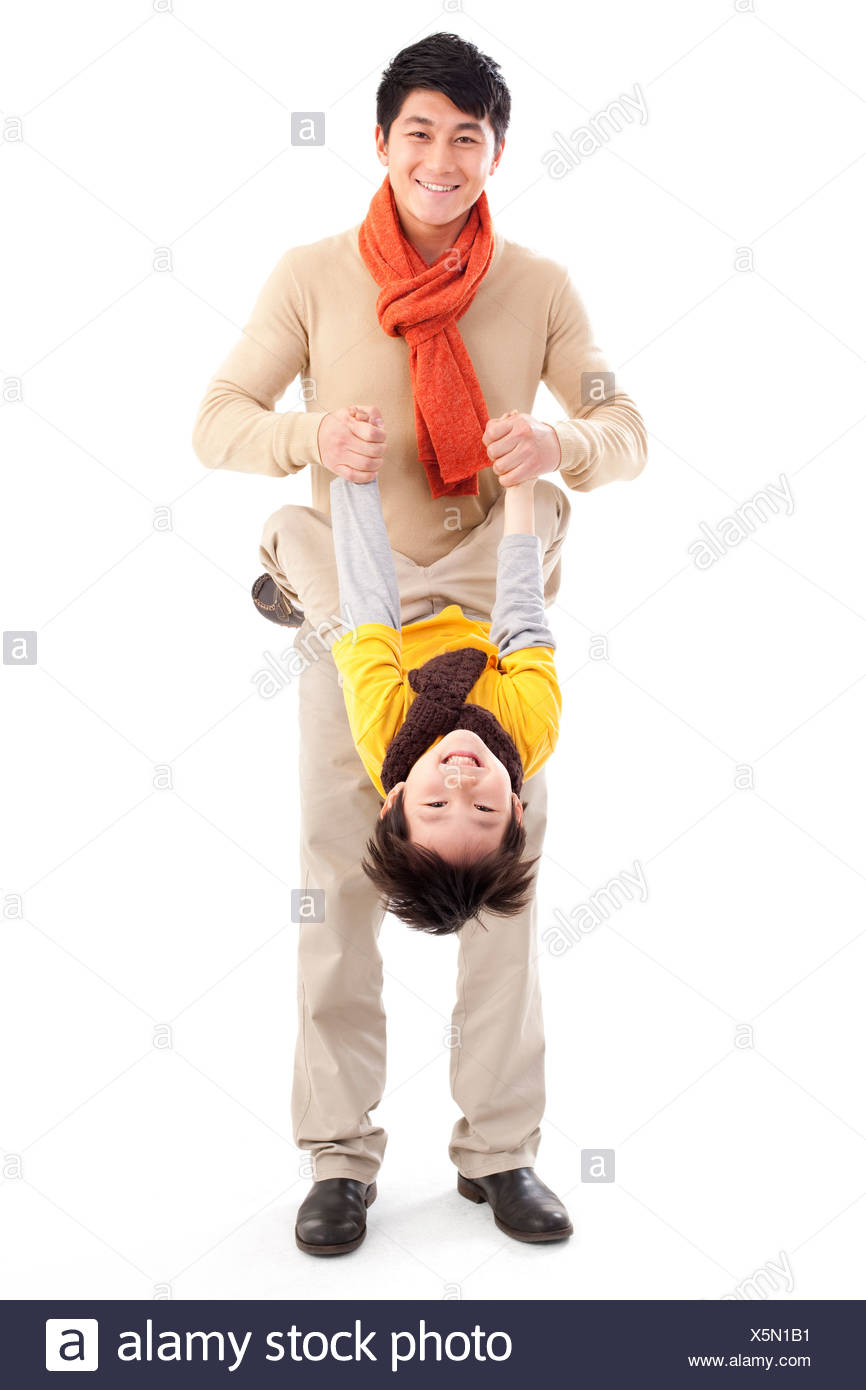 Father playing with his son - Stock Image