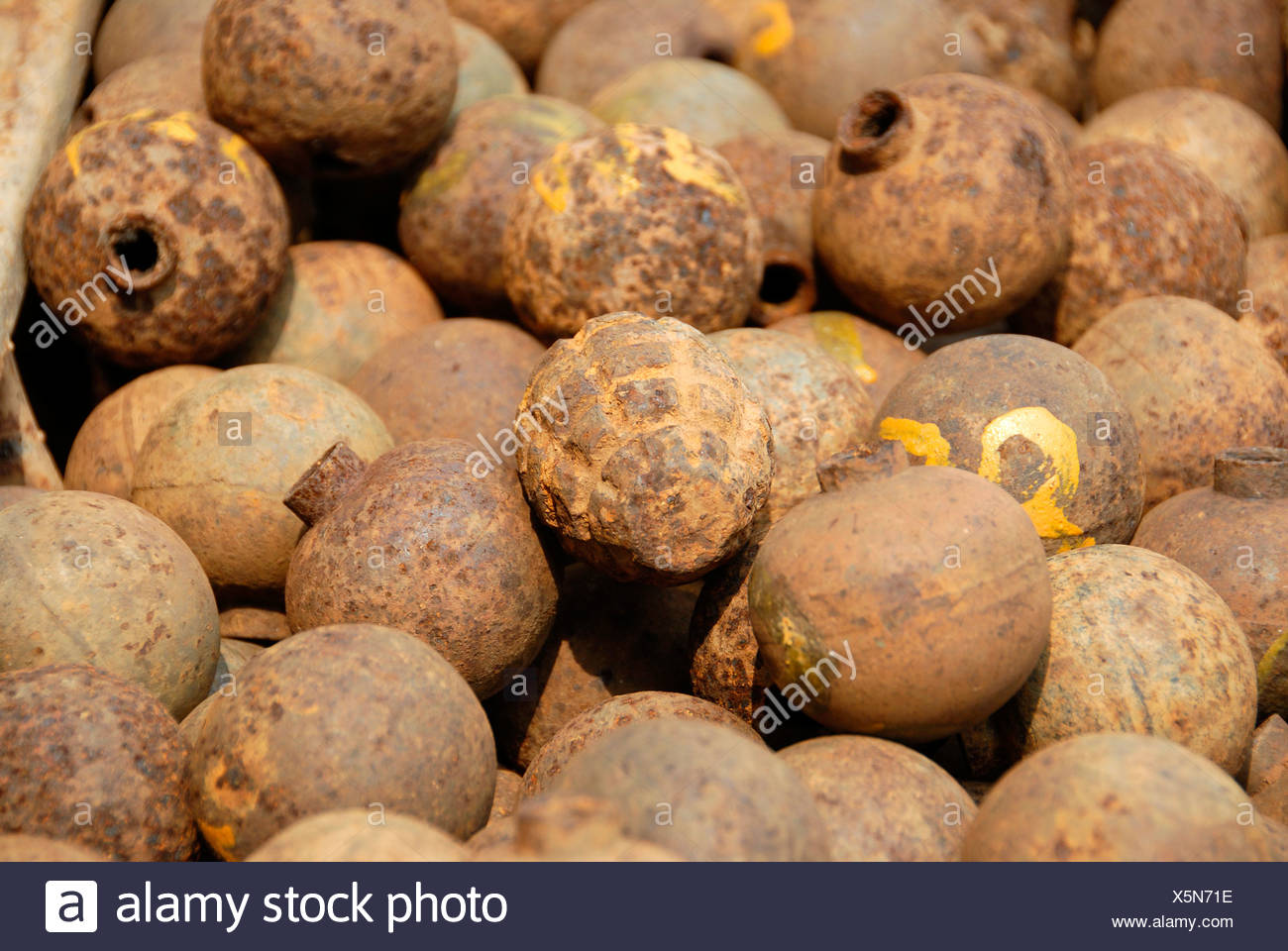 Collection of old rusty American bombs, 'Bombies', dropped on Laos during the 2nd Indochina war by the US Airforce, Vietnam war - Stock Image