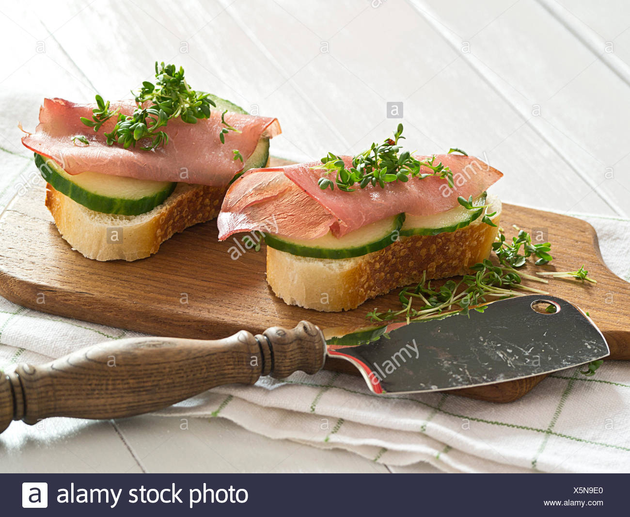 Ham sandwich with cucumber and fresh cress Stock Photo