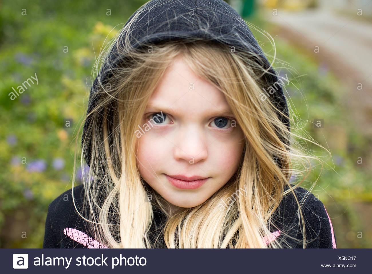 Portrait of girl wearing hood - Stock Image