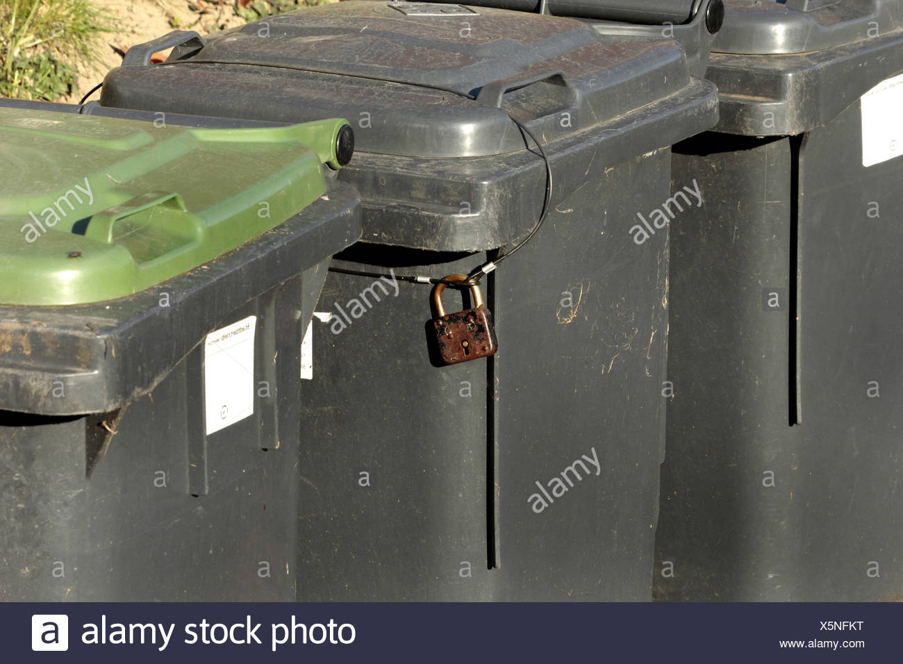 garbage can closed with a lock, Germany, North Rhine-Westphalia - Stock Image