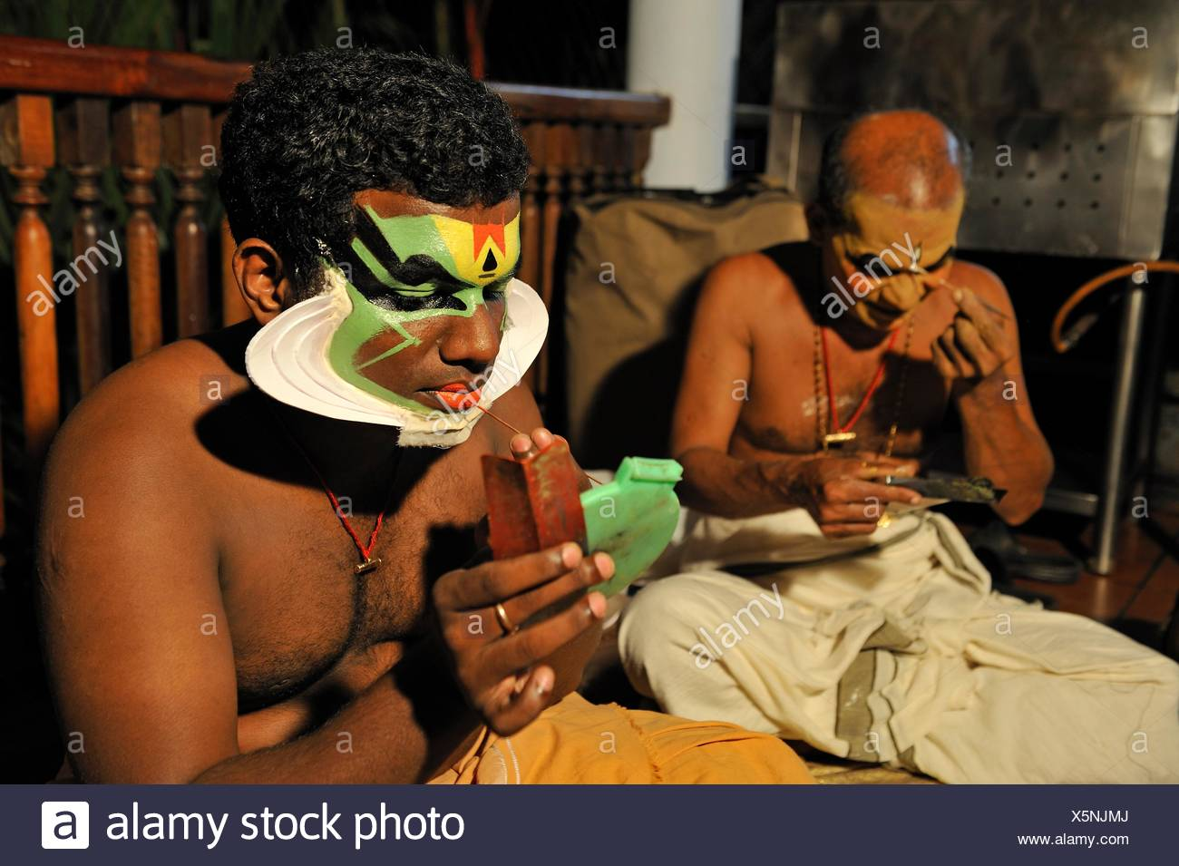 Kathakali performers during making up before a show at the Kumarakom Lake Resort hotel, Kerala state, South India, Asia. - Stock Image