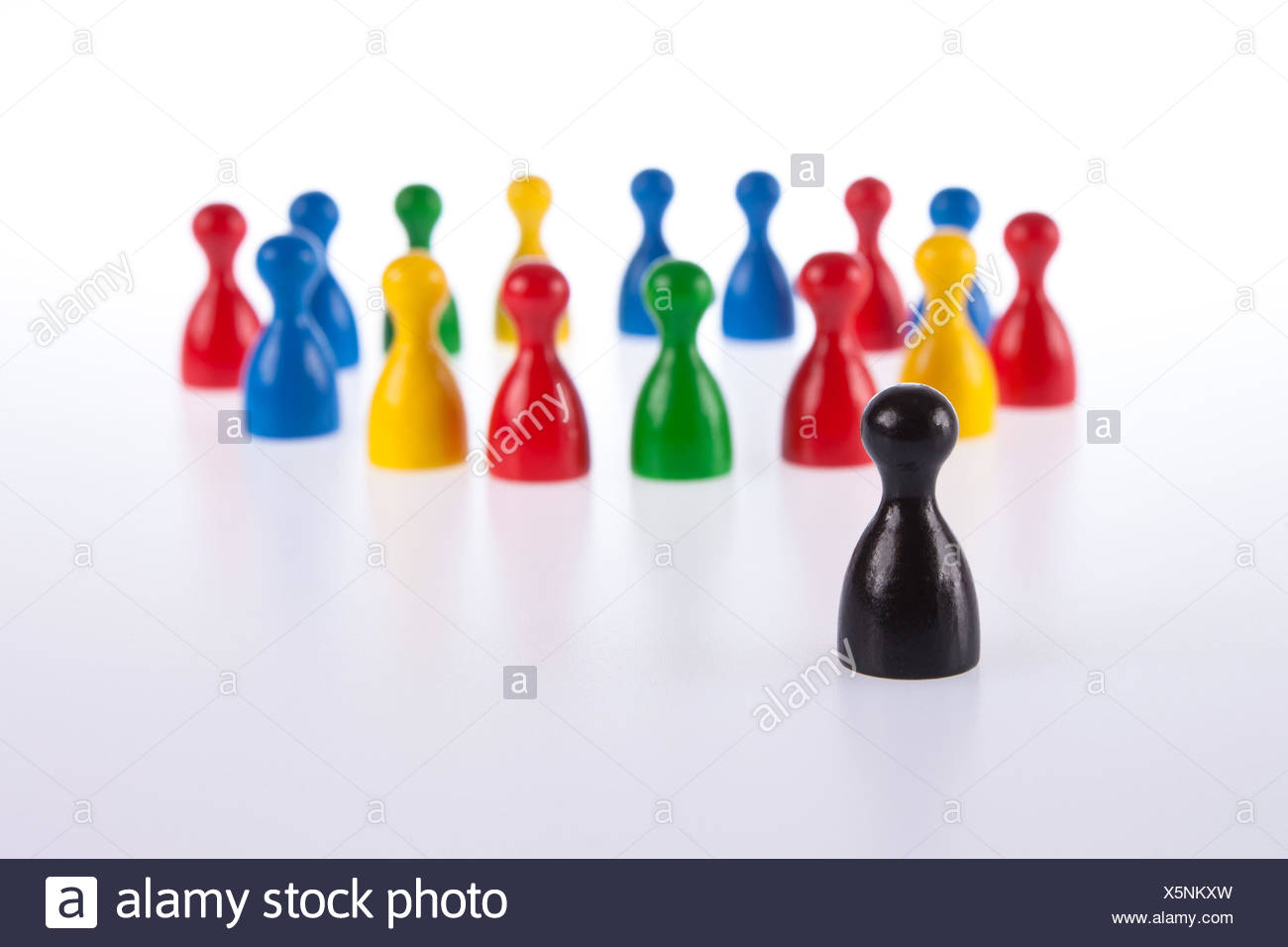 Gaming pieces symbolise exclusion, - Stock Image
