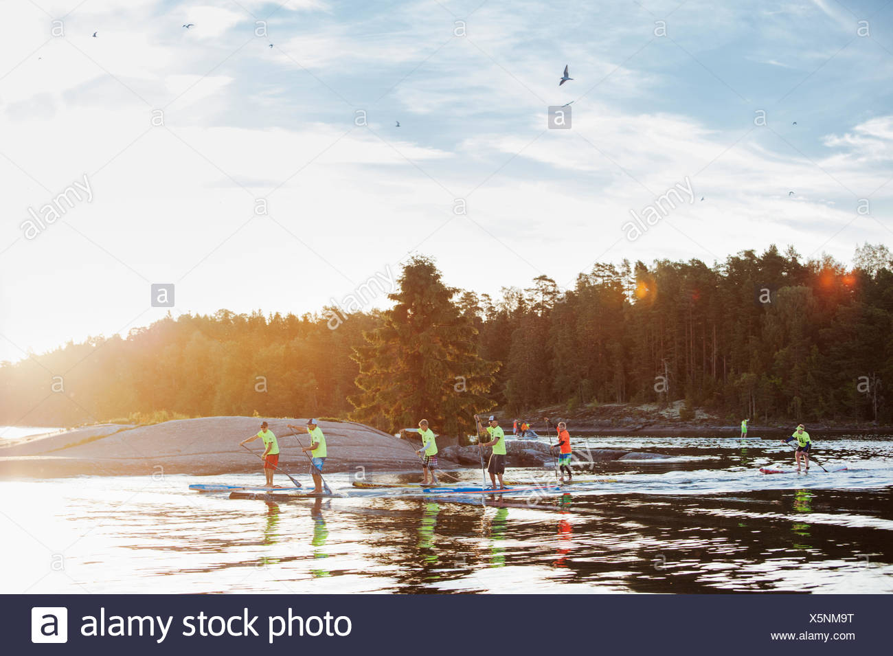 Finland, Varsinais-Suomi, Eura, Paddlers by shore during race - Stock Image