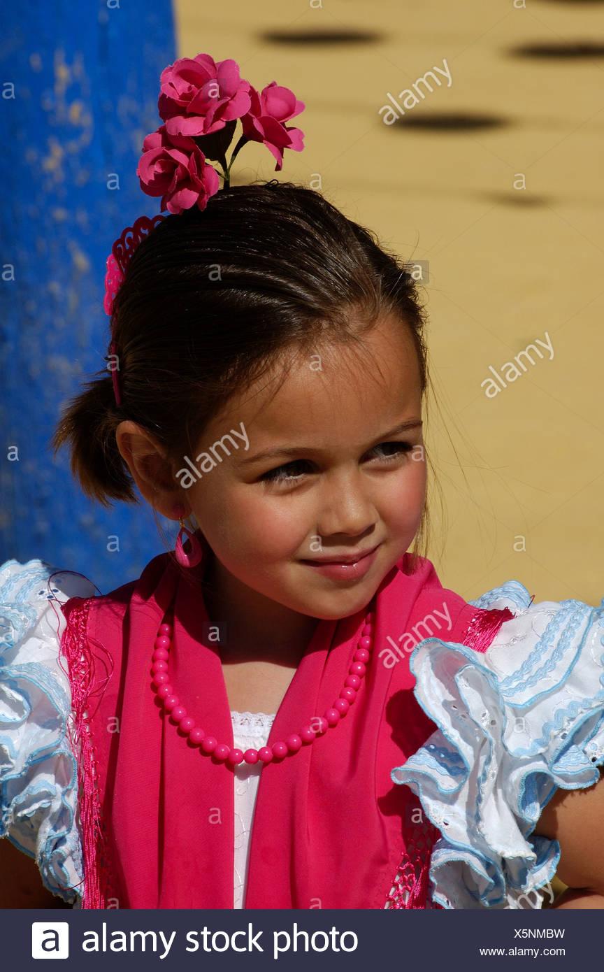 Portrait of a girl in Traje de Gitana , Feria de Abril , Sevilla , Andalusia , Europe Stock Photo