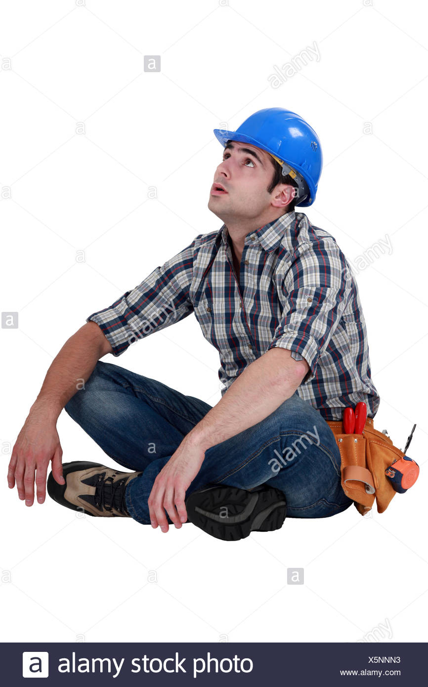 Tired builder taking well earned break - Stock Image