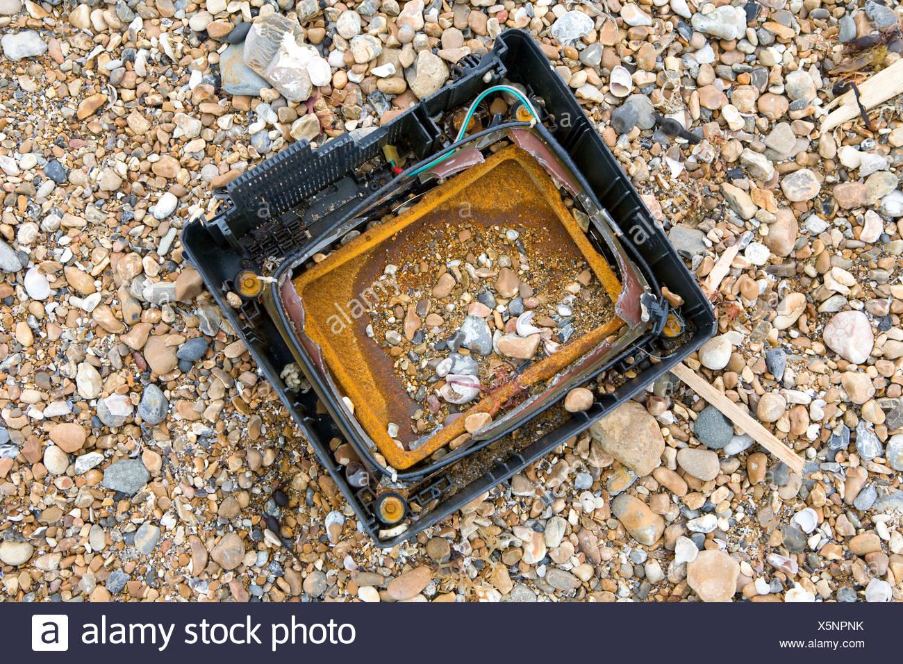 TV on pebble beach - Stock Image