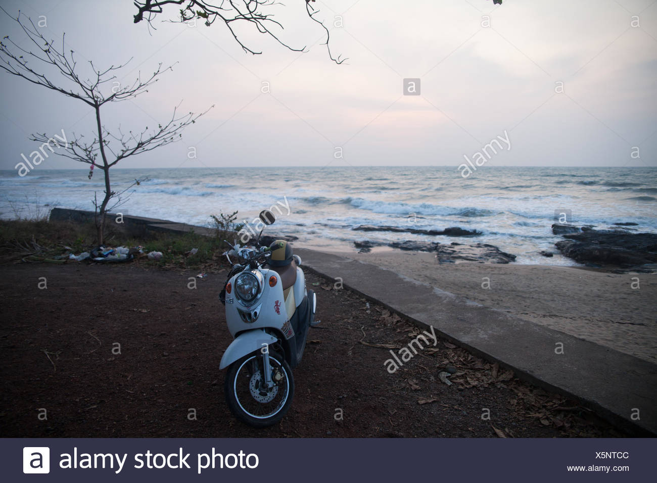Motor Scooter On Beach - Stock Image