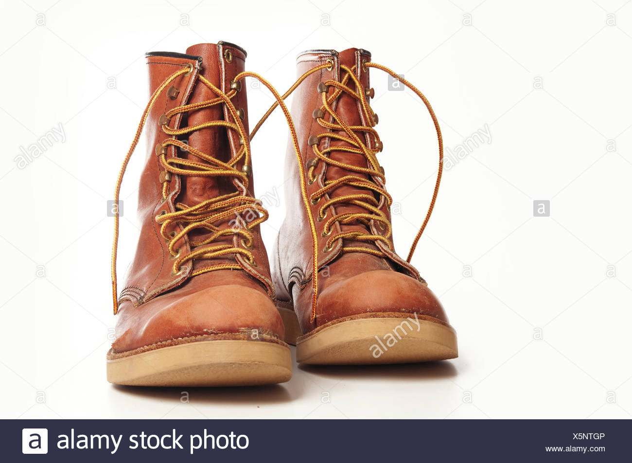 Men's rugged leather boots isolated against white background - Stock Image