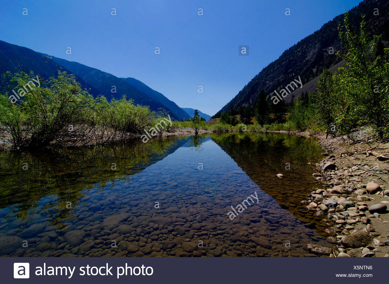 The shapes and curves of the rugged terrain along the Similkameen River, near Keremeos, in the Simikameen region of British - Stock Image