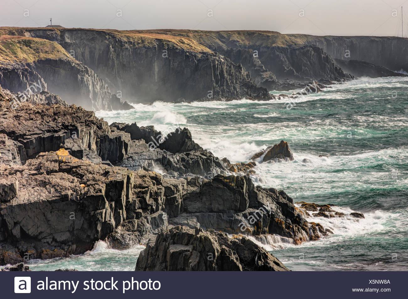 Waves breaking on coastline, Cape Race, Newfoundland, Canada - Stock Image