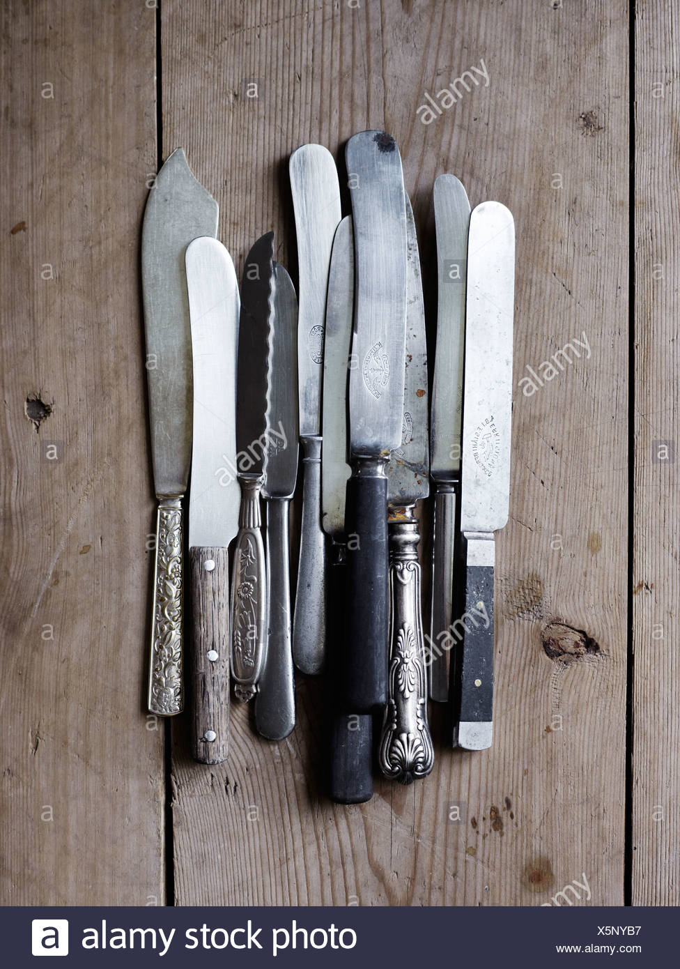 Scandinavia, Sweden, Knives on wooden background, close-up - Stock Image