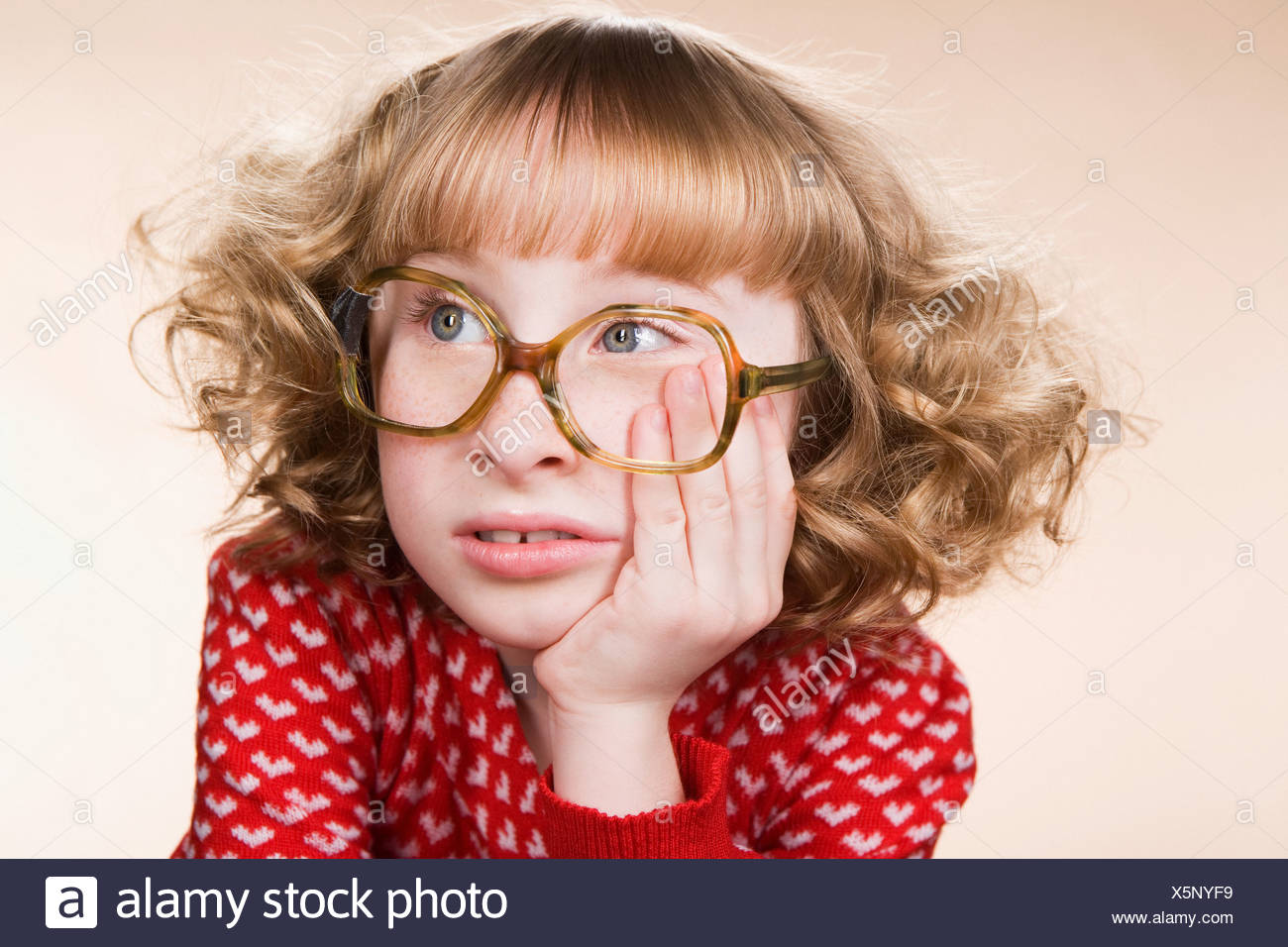 Portrait of a bored geeky girl - Stock Image