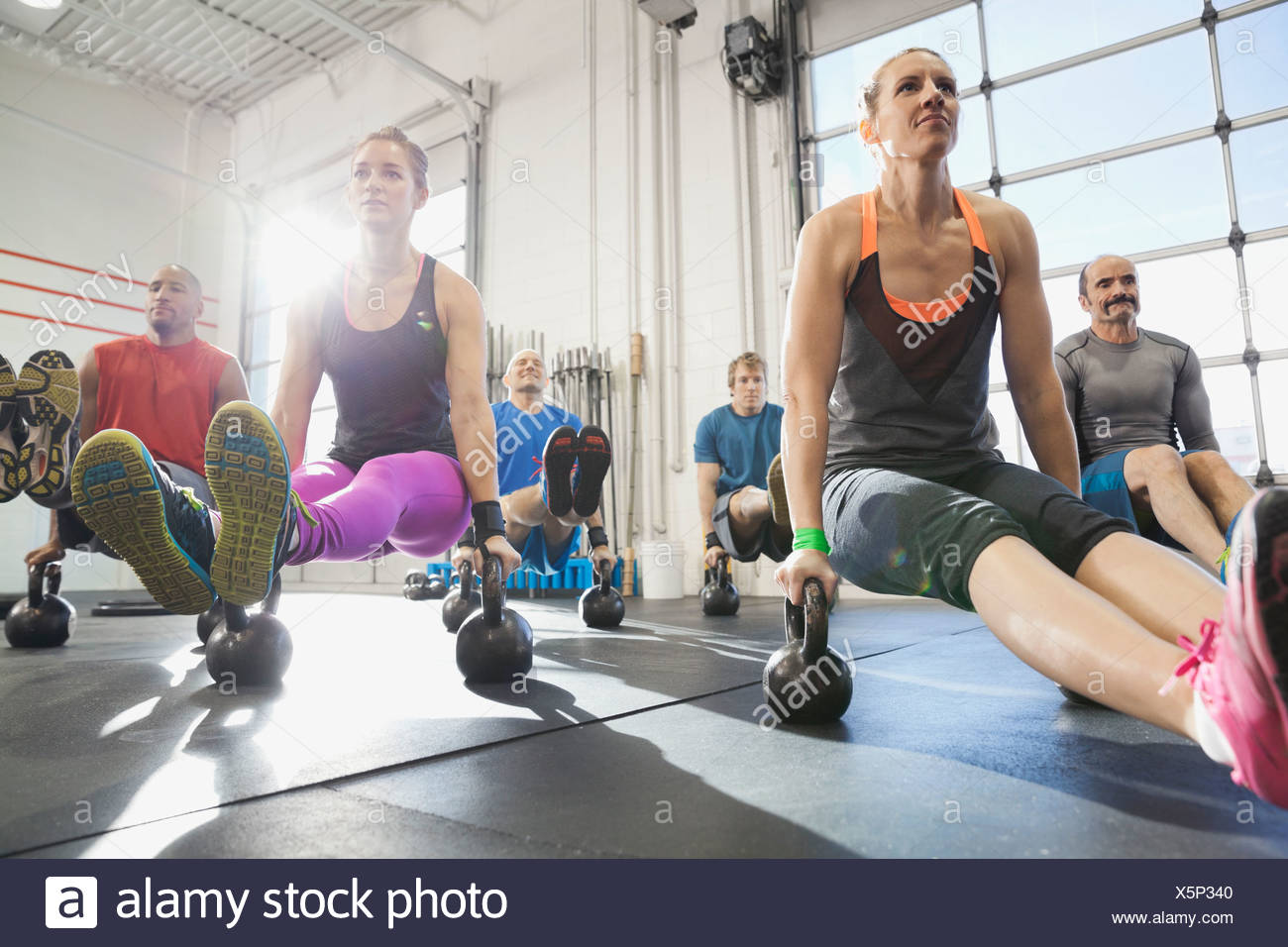Group working out with kettlebells - Stock Image