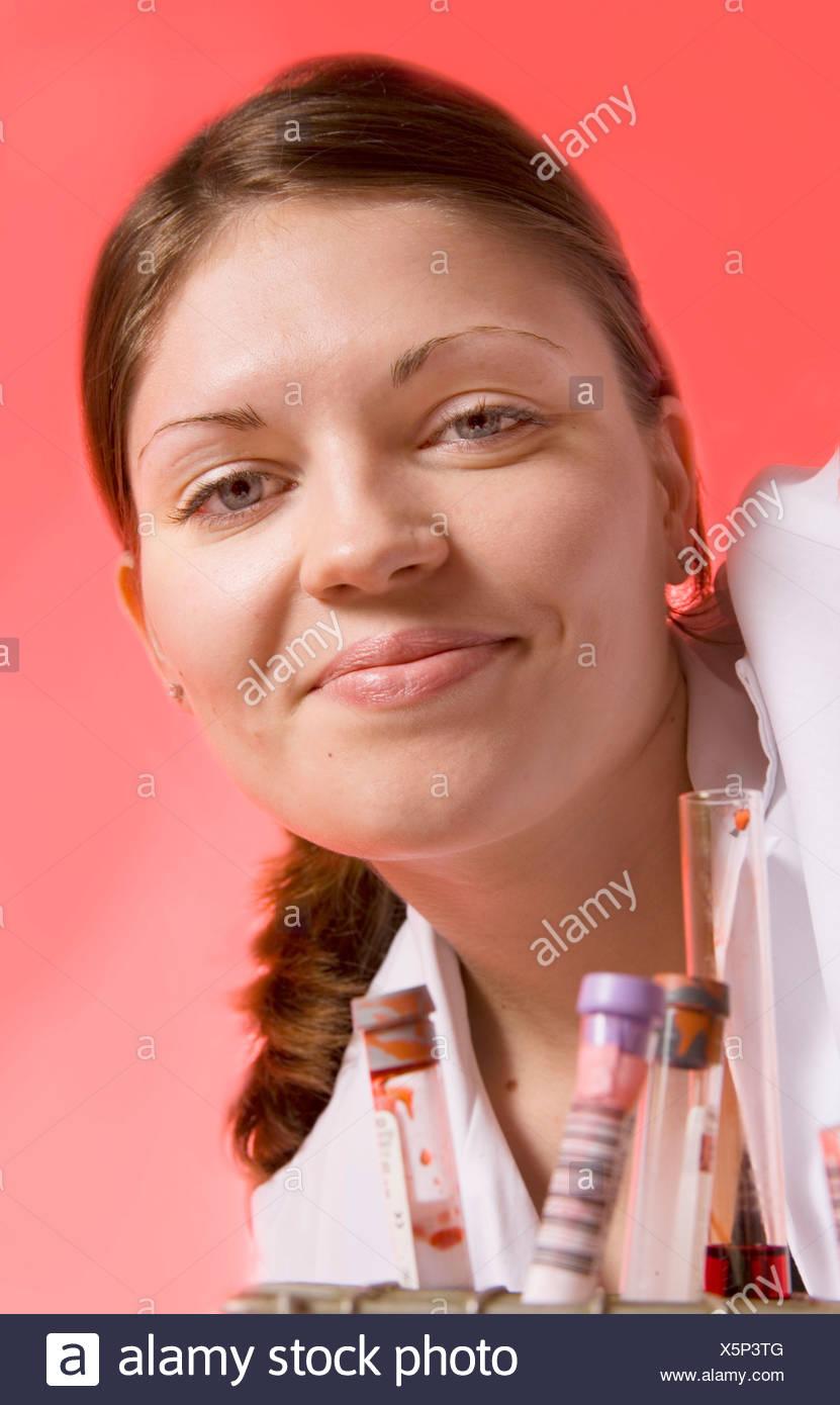 Clinical chemist examining pathology samples. - Stock Image