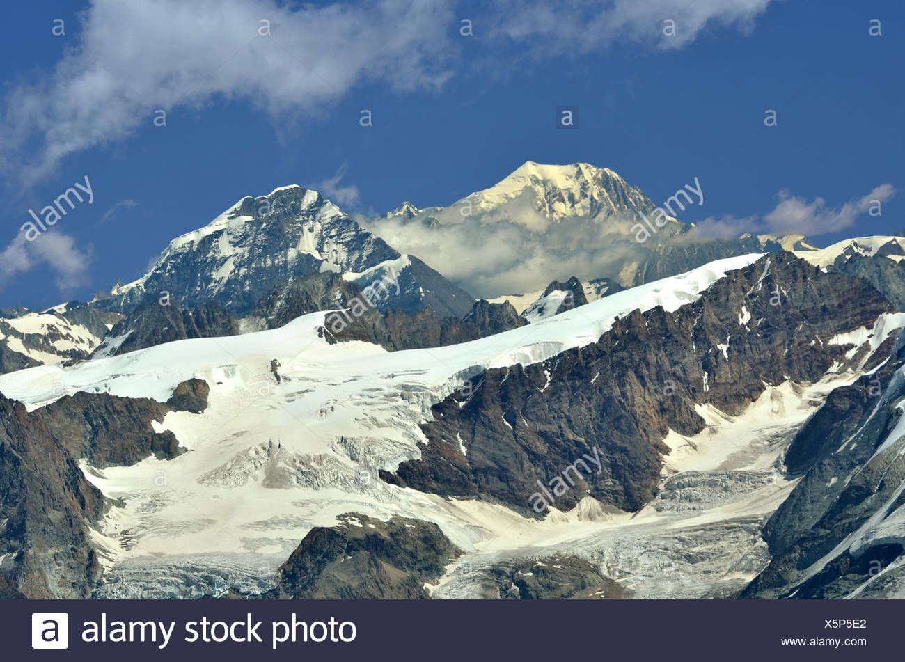 Left of centre : the Grand Combin, Right Mont Colon and the Pigne d'Arolla. In the foreground the Tete Blanche (c) and the Tete - Stock Image