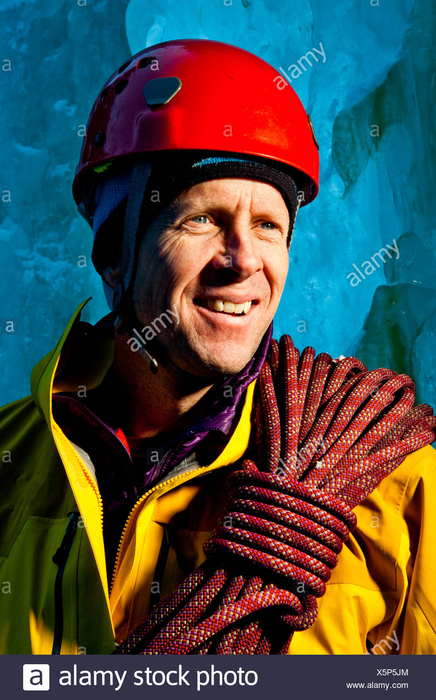 Ice Climber and mountaineer poses for a portrait at Hidden Falls. - Stock Image