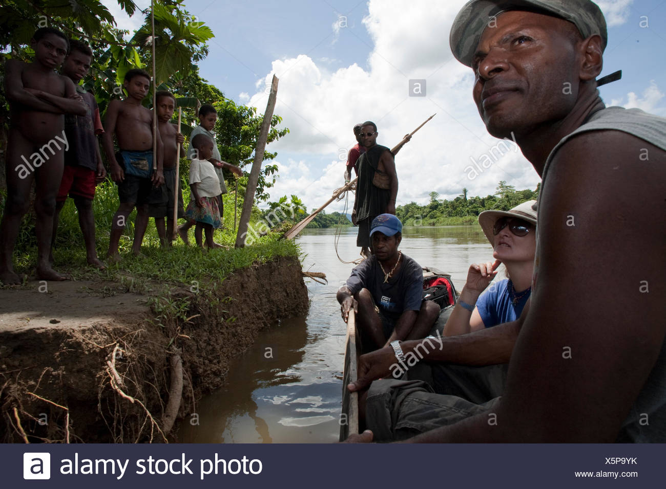 An anthropological researcher and ethnographer study indigenous cultures. - Stock Image