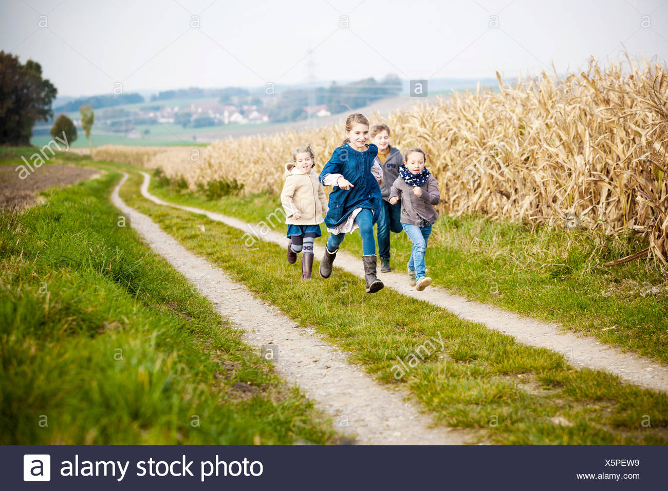 Four children playing outdoors - Stock Image