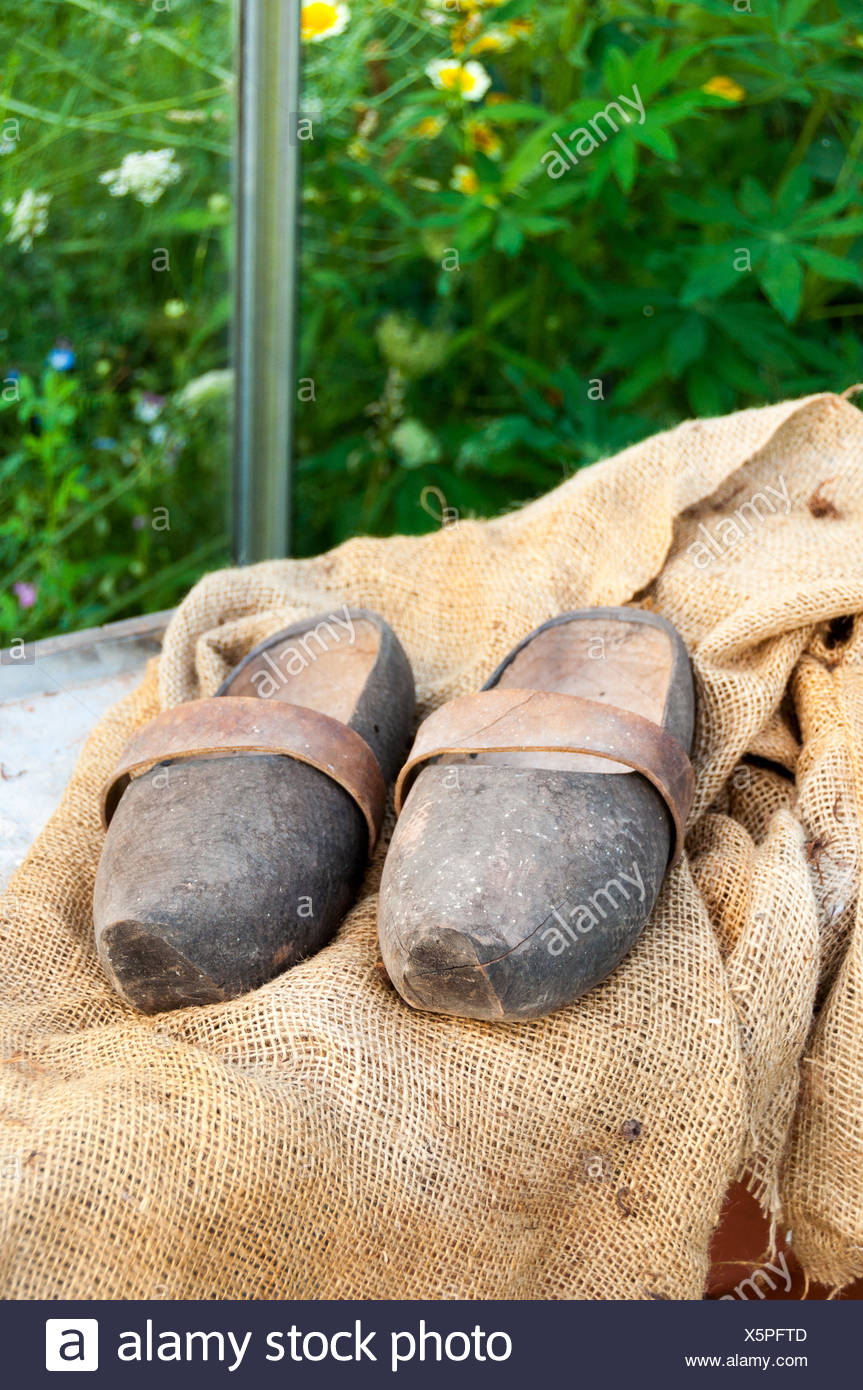 Garden clogs on hessian - Stock Image