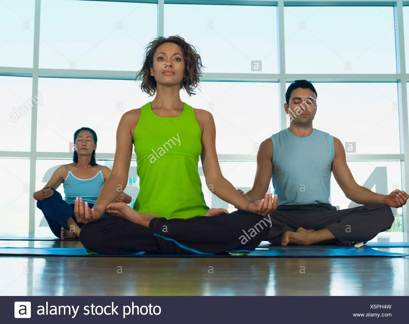 three people doing yoga indoors stock photo 278935577 alamy