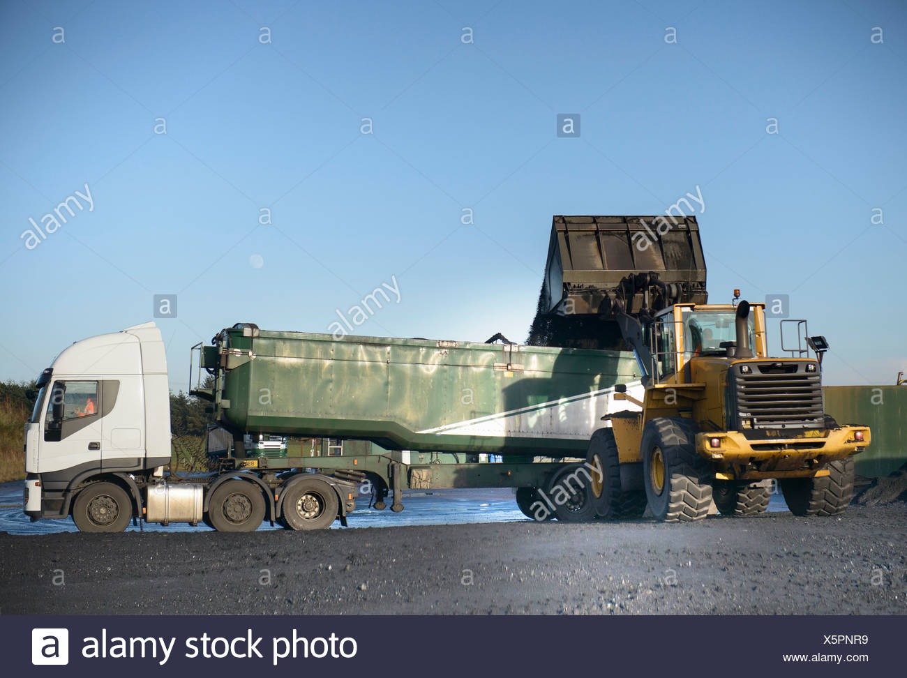 Coal loaded onto truck at surface mine - Stock Image