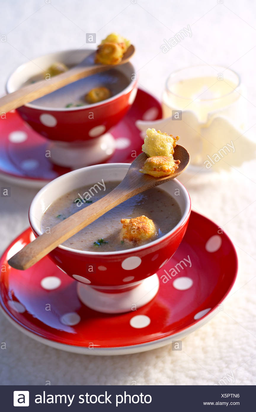 cooking Mushrooms Cream Soup - Stock Image