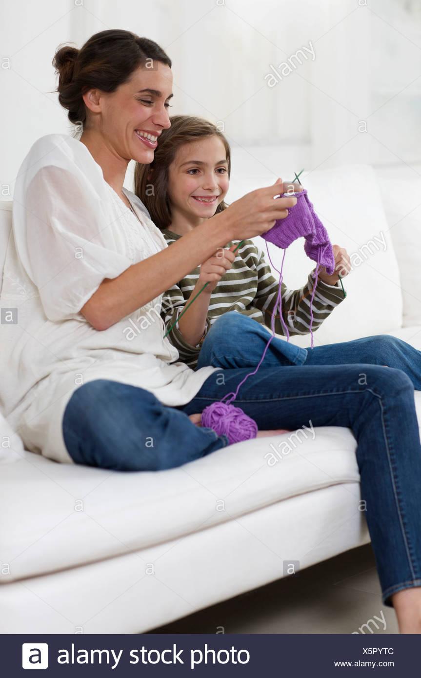 little girl interested in knitting - Stock Image