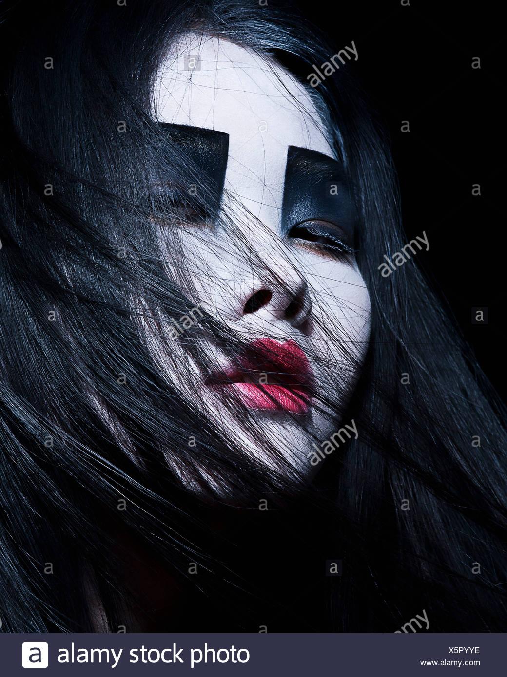 Young woman with dramatic makeup, black eyeshadow - Stock Image