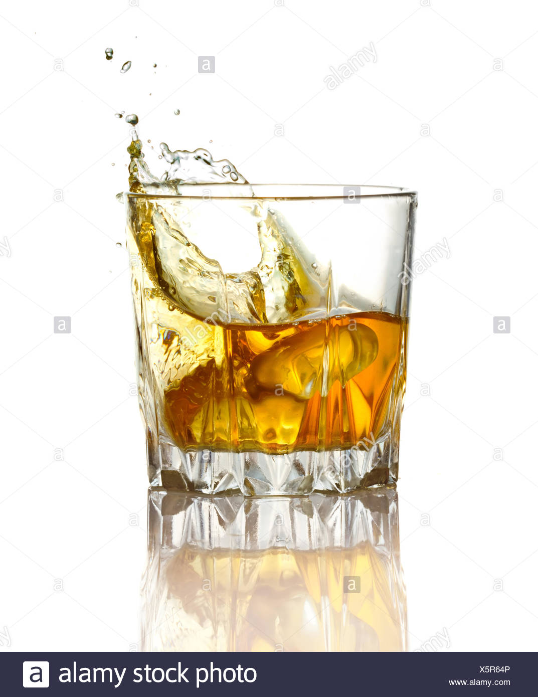 Splash in glass of whiskey and ice isolated Stock Photo