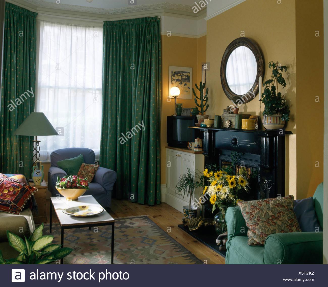 Vase Of Yellow Summer Flowers In Fireplace In Nineties