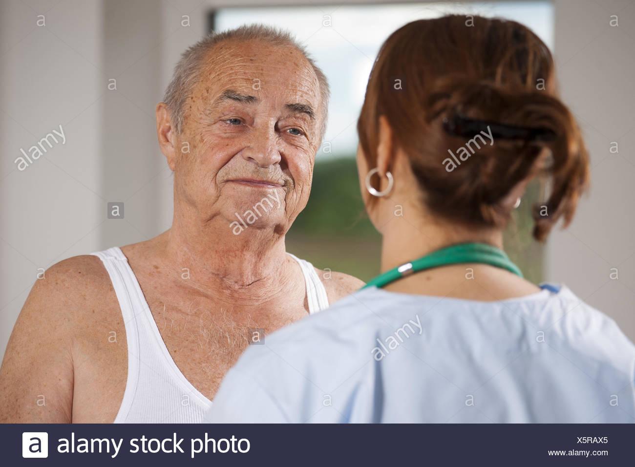 Nurse cares about a senior man, - Stock Image
