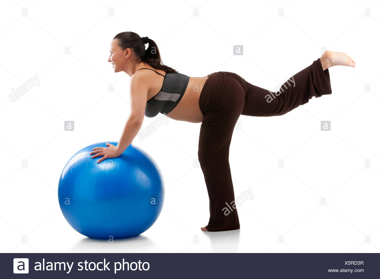 pregnant woman doing relaxation with birth ball - Stock Image