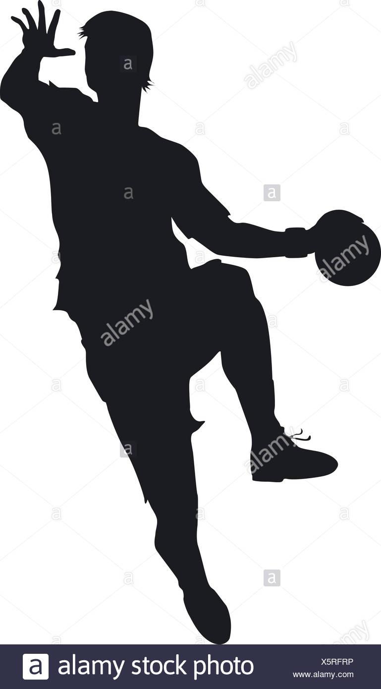 Ein Handballer beim entschlosssenen Sprungwurf auf das Tor Stock Photo