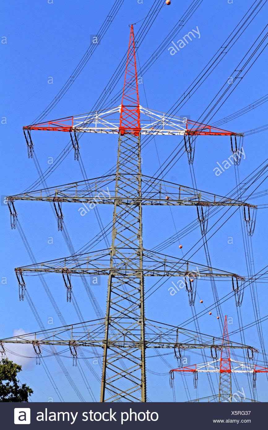 power pole and high voltage power line, Germany - Stock Image