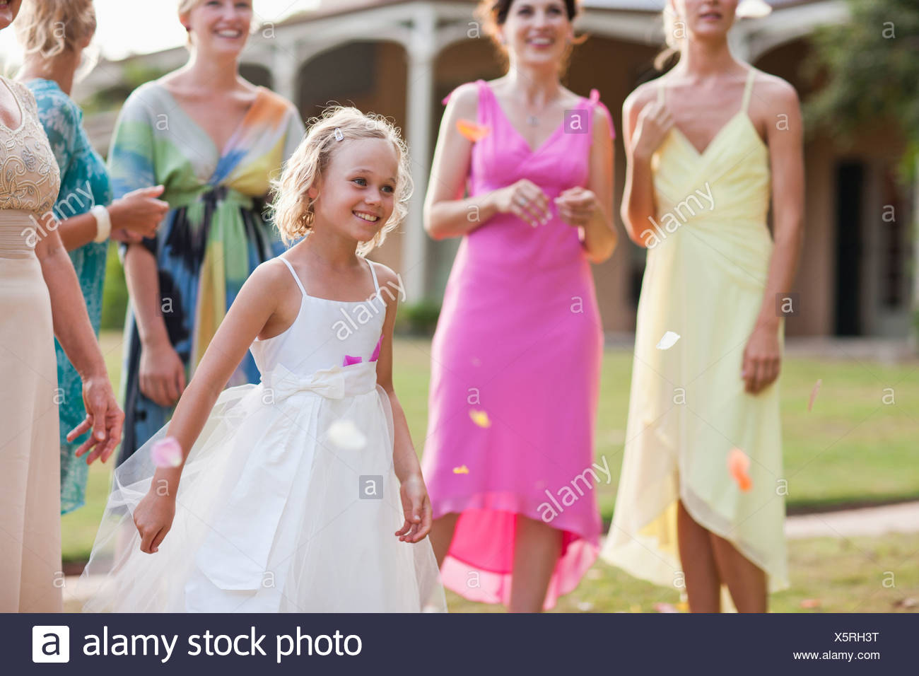 Flower girl at wedding reception - Stock Image