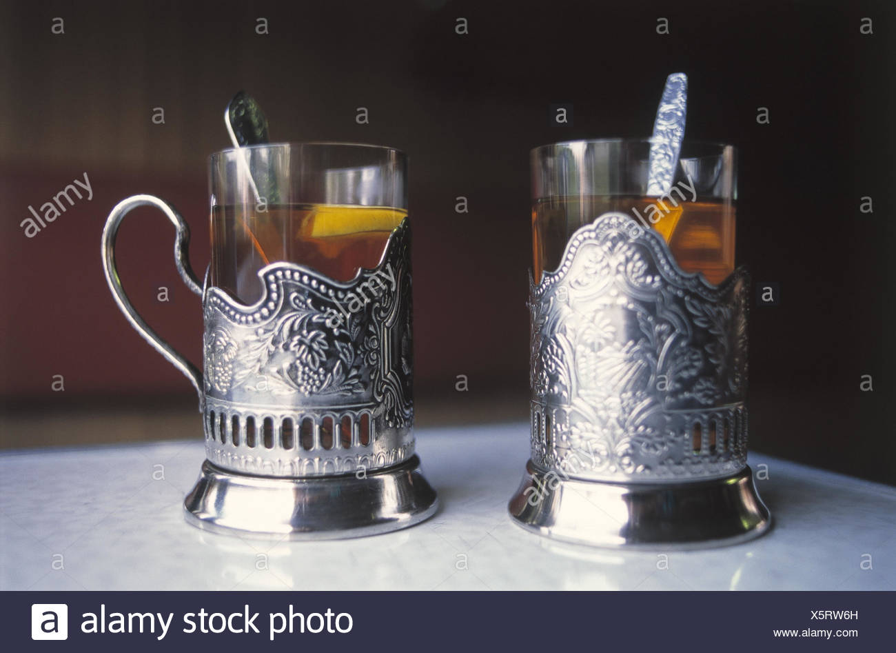 Russia, tea glasses, holders, silver CIS, tea, glasses, drinks, typically, tradition, thirst, dishes, teaspoon, spoon, anti-alcoholic, alcohol-free, object photography - Stock Image