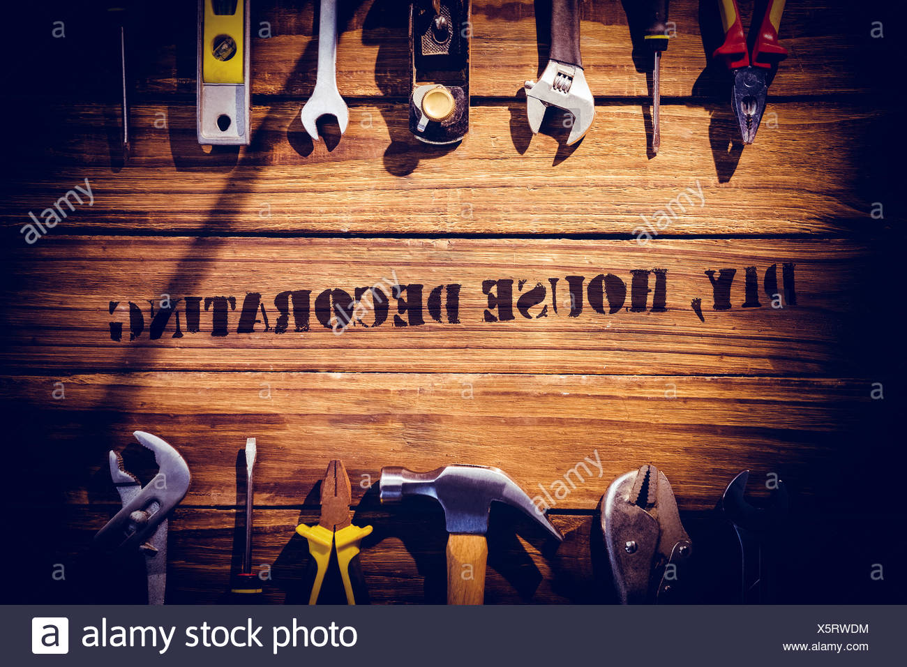 Diy house decorating against desk with tools - Stock Image
