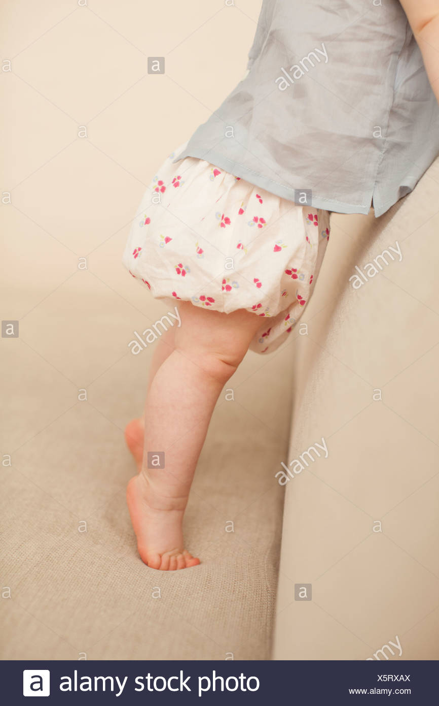 Close up of toddler?s chubby legs - Stock Image