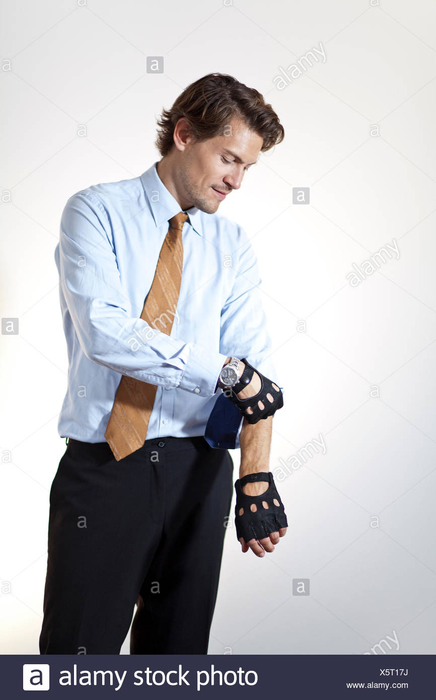 Brute businessman pulling up sleeves - Stock Image