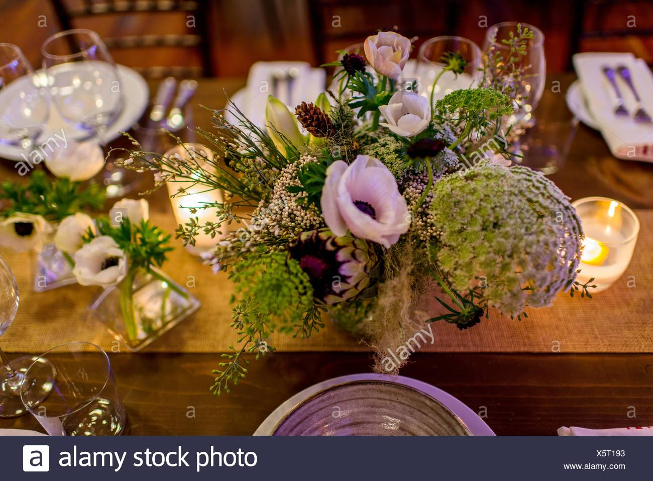 Flower Arrangement On Dinner Party Table Stock Photo Alamy