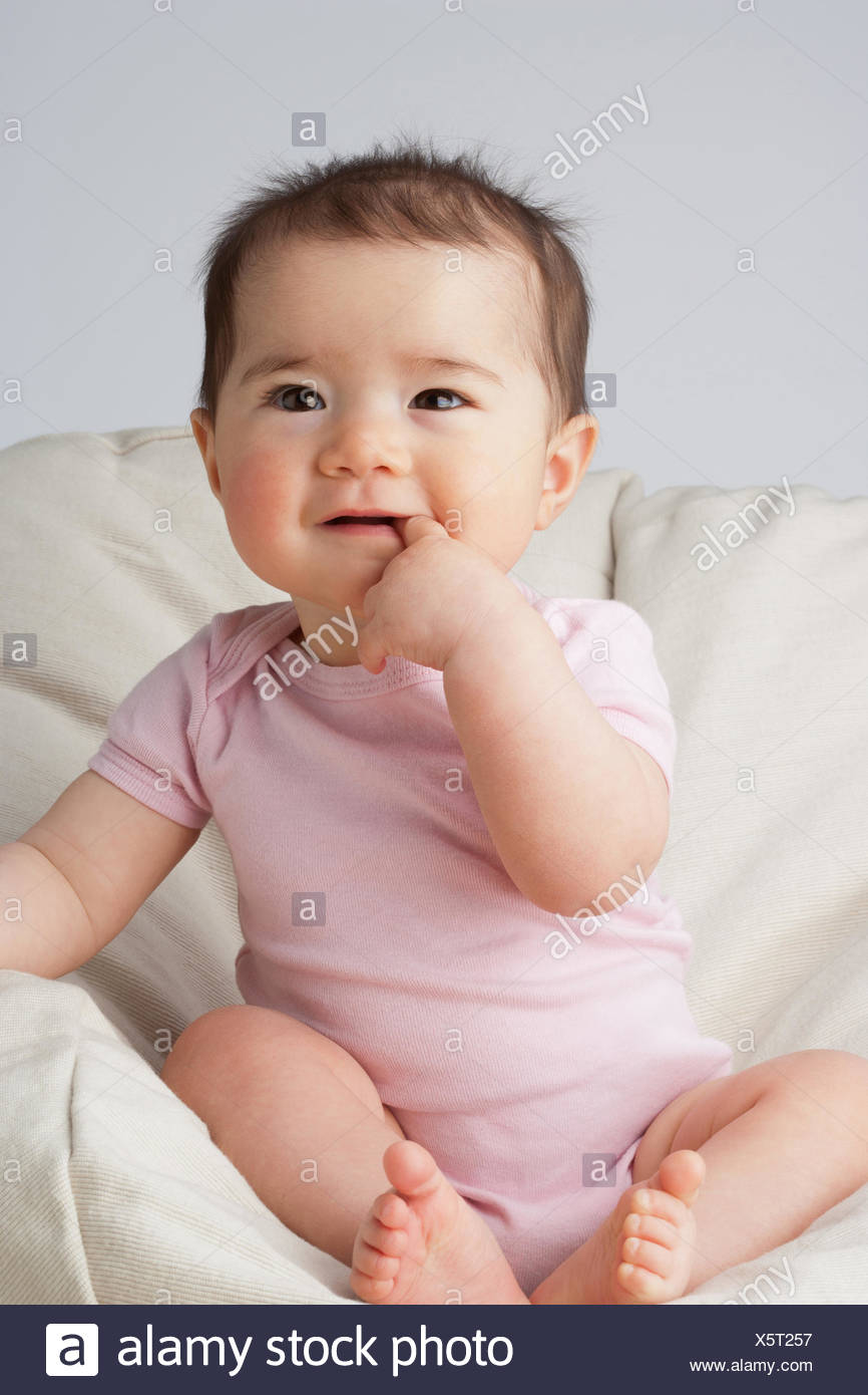 A baby in a beanbag chair Stock Photo