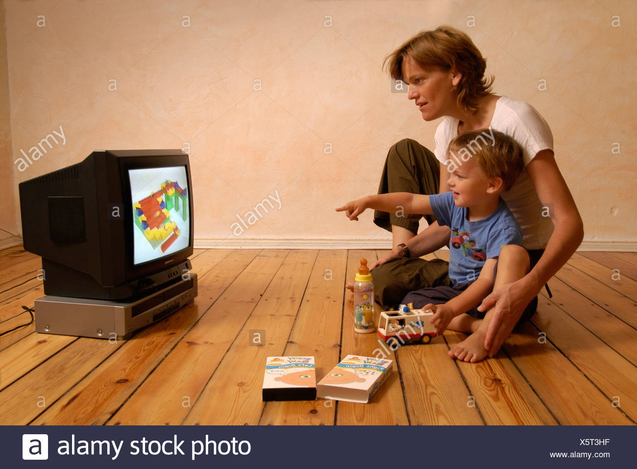 Mother and child watching a video - Stock Image