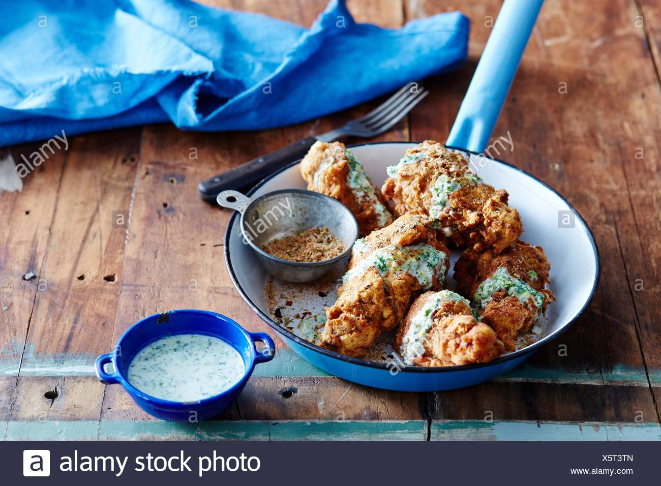 Cajun fried chicken with green chilli dressing - Stock Image