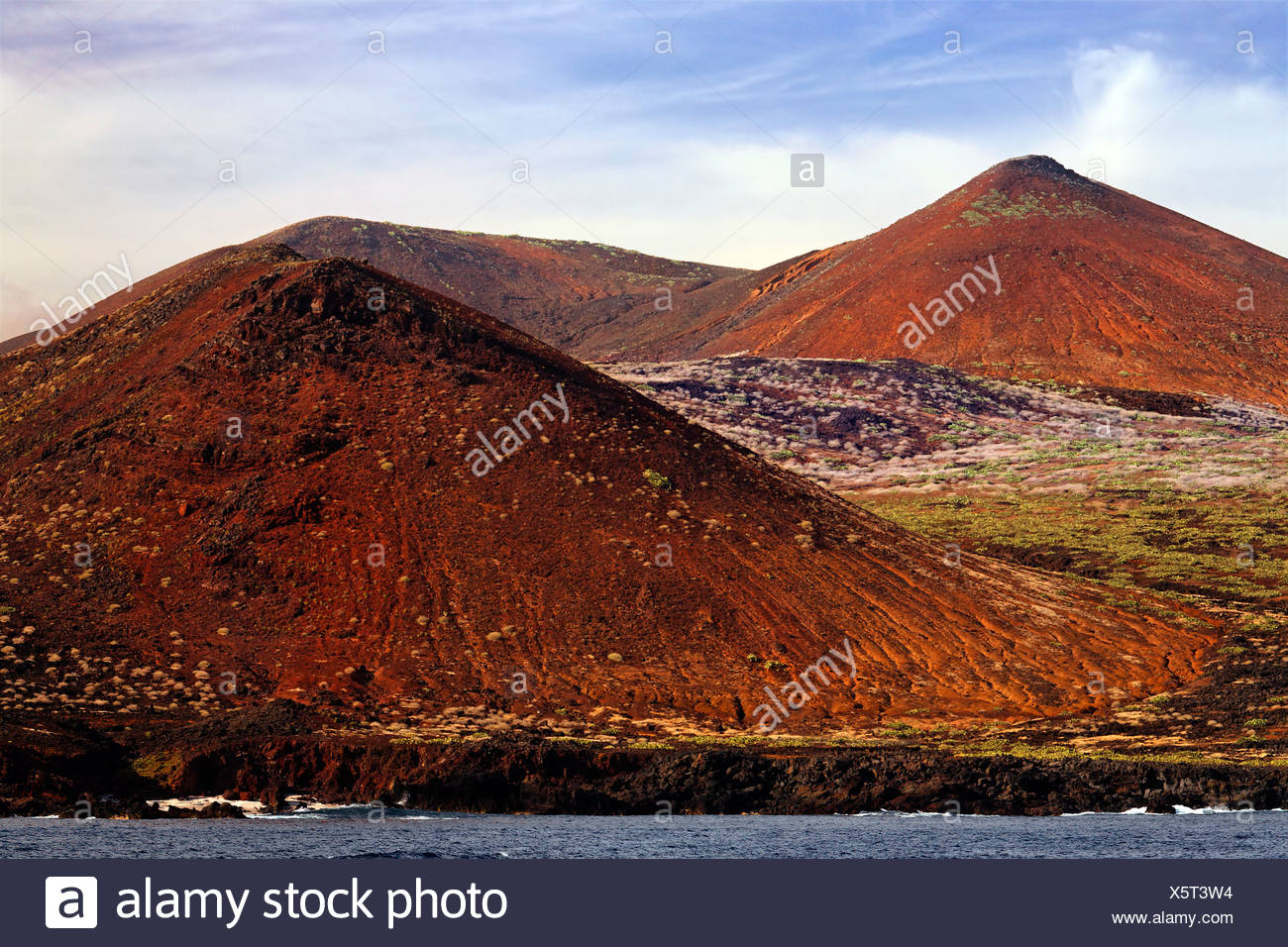 Barren landscape of volcanic hills on the coast, San Benedicto Island, near Socorro, Revillagigedo Islands, archipelago, Mexico - Stock Image