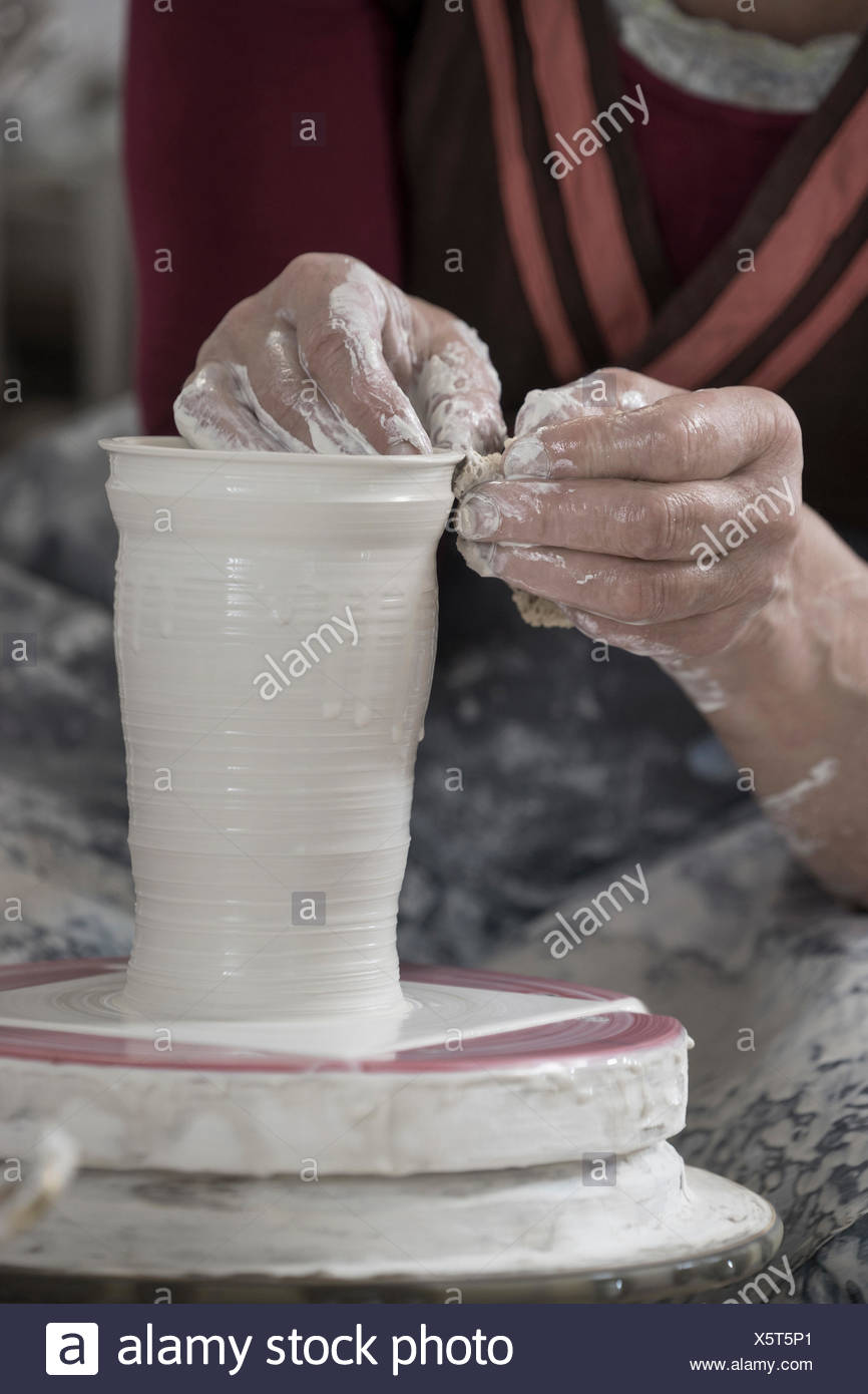 Close-up of female potter moulding clay in workshop, Bavaria, Germany Stock Photo