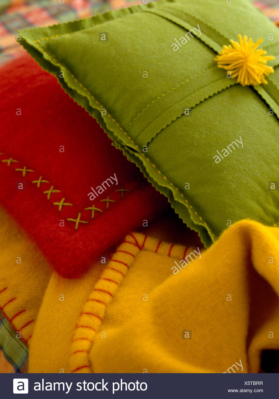 Close Up Of Colourful Felt Cushions With Decorative Cross Stitch And Blanket Stitch Stock Photo Alamy
