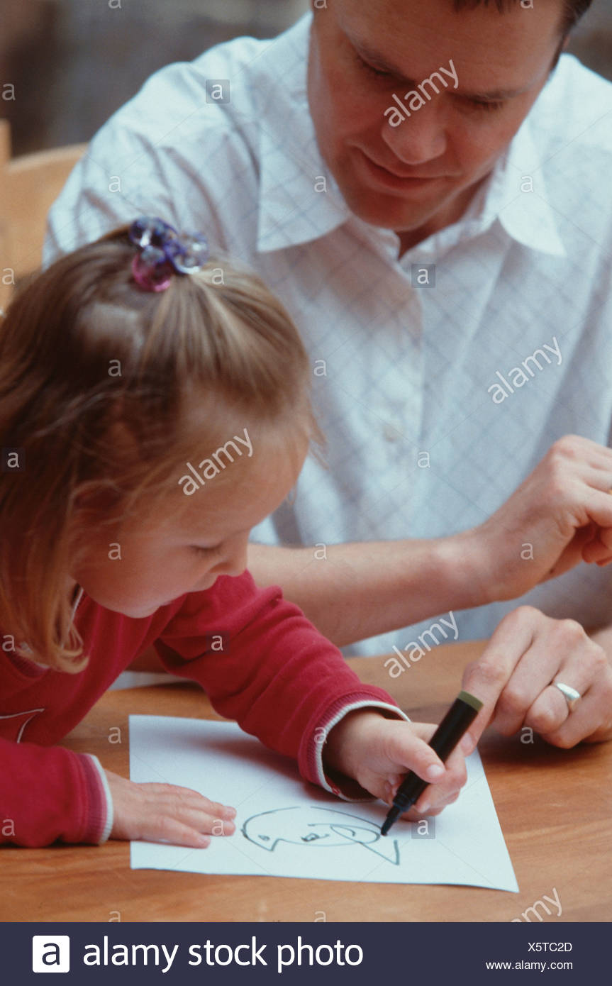 Father With Short Brown Hair Sitting At Table With Female Child